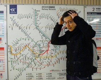 Darren trying to figure out the Japanese Subway System