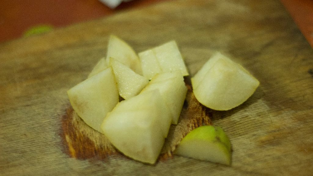Take a deep bowl and start to make the dough Then cut the second pear into small pieces but don