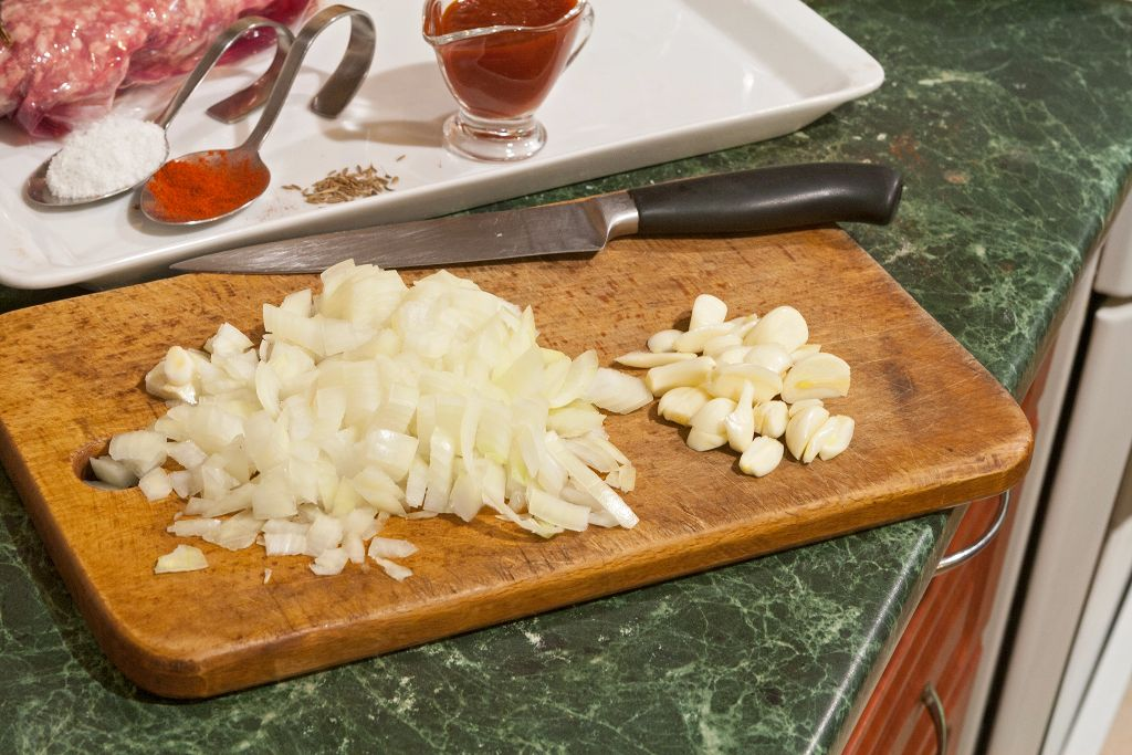 Cutting the garlic and yellow onions