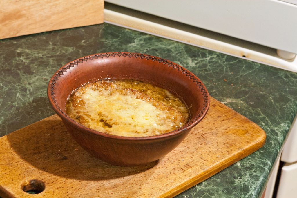 Taking out the ready French onion soup