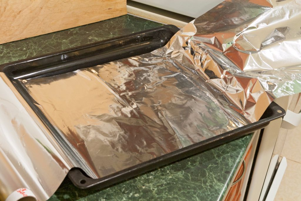 Covering the baking sheet with some foil