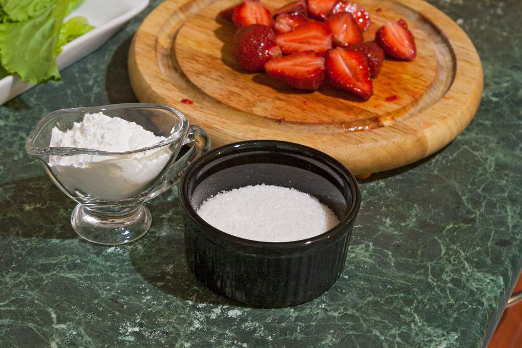 Combining your strawberries with cornstarch and sugar