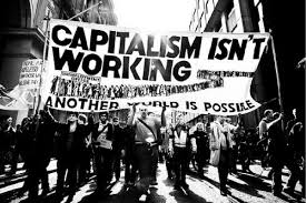 """Marchers with banner that reads, """"Capitalism Isn't Working: Another World is Possible"""""""