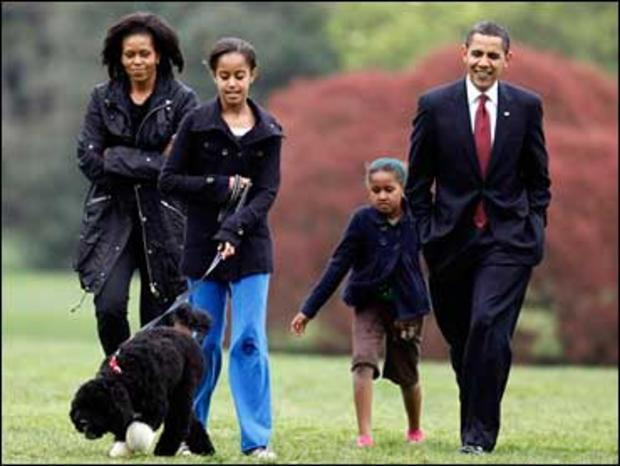 Malia Obama walks with new dog Bo, followed by President Barack Obama, Sasha Obama and first lady Michelle Obama on the South Lawn at the White House in Washington, Tuesday, April 14, 2009.
