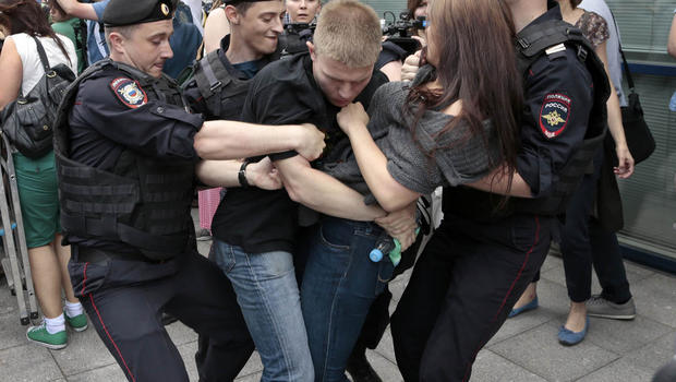 Police officers detain gay rights activists as they gathered near the State Duma, Russia's lower parliament chamber, in Moscow, Russia, on June 11, 2013.  AP PHOTO/IVAN SEKRETAREV