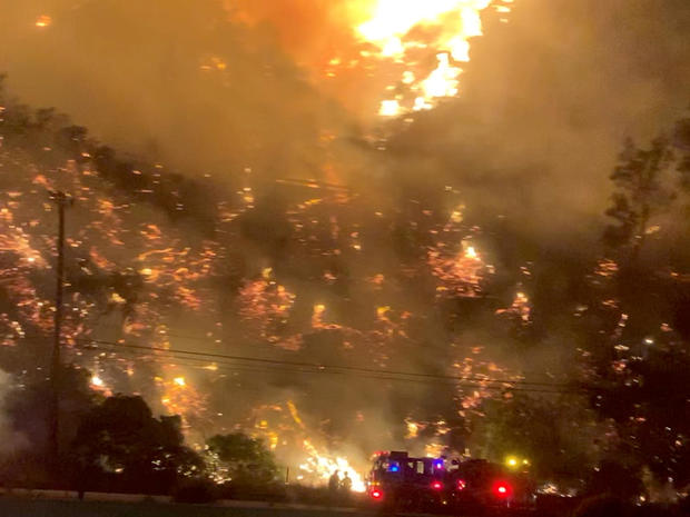 A wildfire is seen near the Getty Center in Los Angeles October 28, 2019, in this screen grab obtained from a social media video.