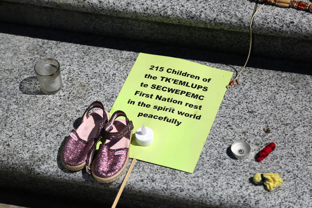 215 pairs of children's shoes were displayed in Vancouver as a tribute to the discovery of the residential school