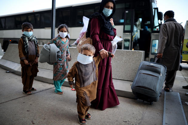 Afghan refugees arrive at Dulles Airport outside the nation's capital