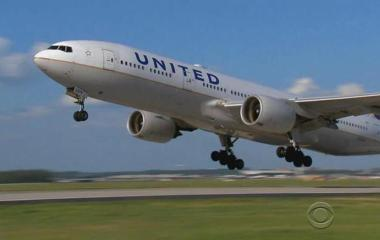 United reaches settlement with passenger, pledges changes