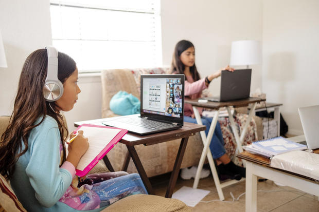 Children Participate in E-Learning Activity at Home