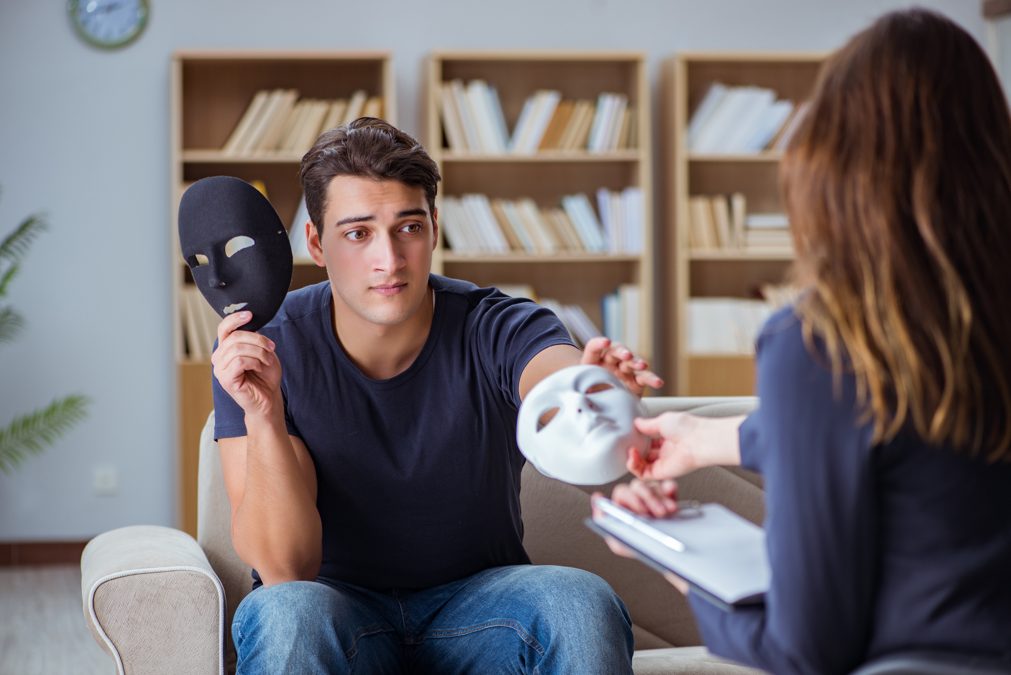 Man Attending Psychology Therapy Session With Doctor