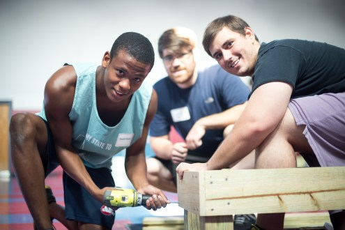 Medical students work on a wash station for Central Elementary's school garden.