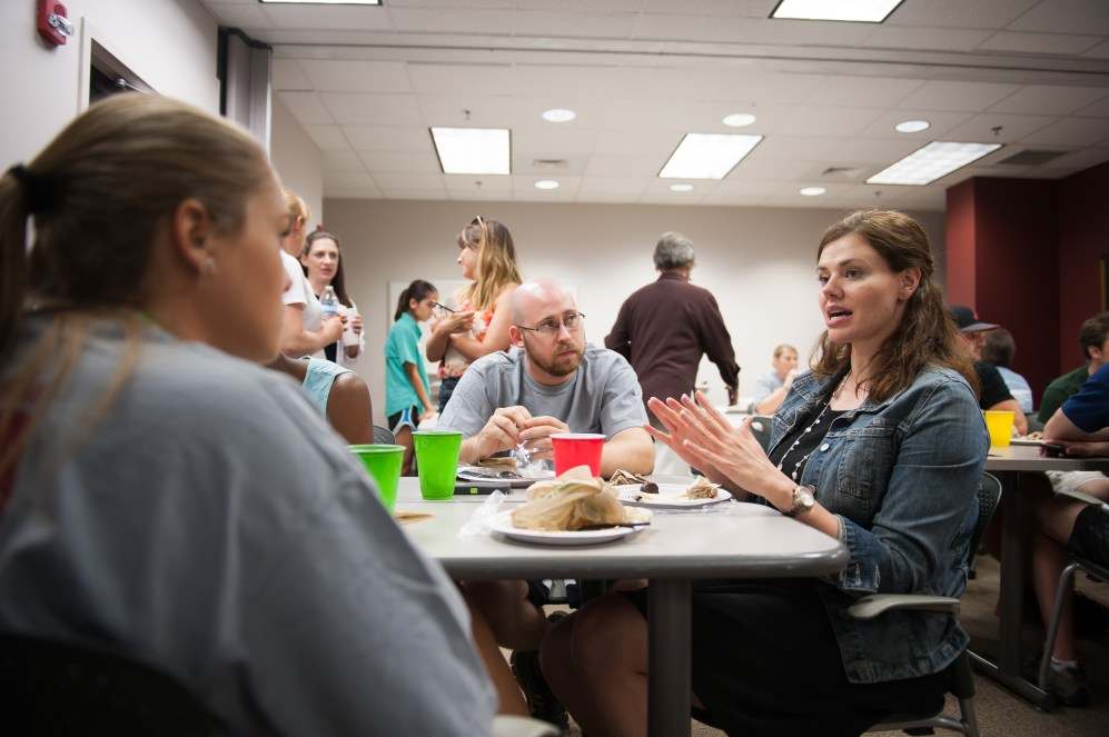 Dr. Lea Yerby, assistant professor in Community and Rural Medicine, talks with a student about what to expect during clinical education at the College.
