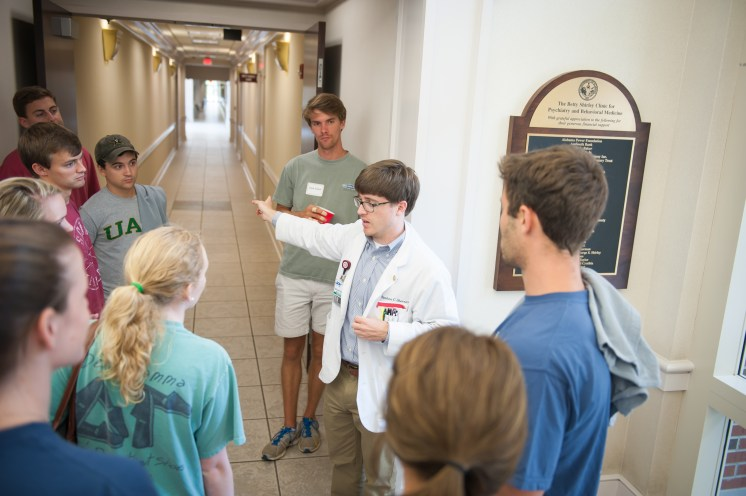 A third-year medical student guides first-year medical students through University Medical Center, which is operated by the College.