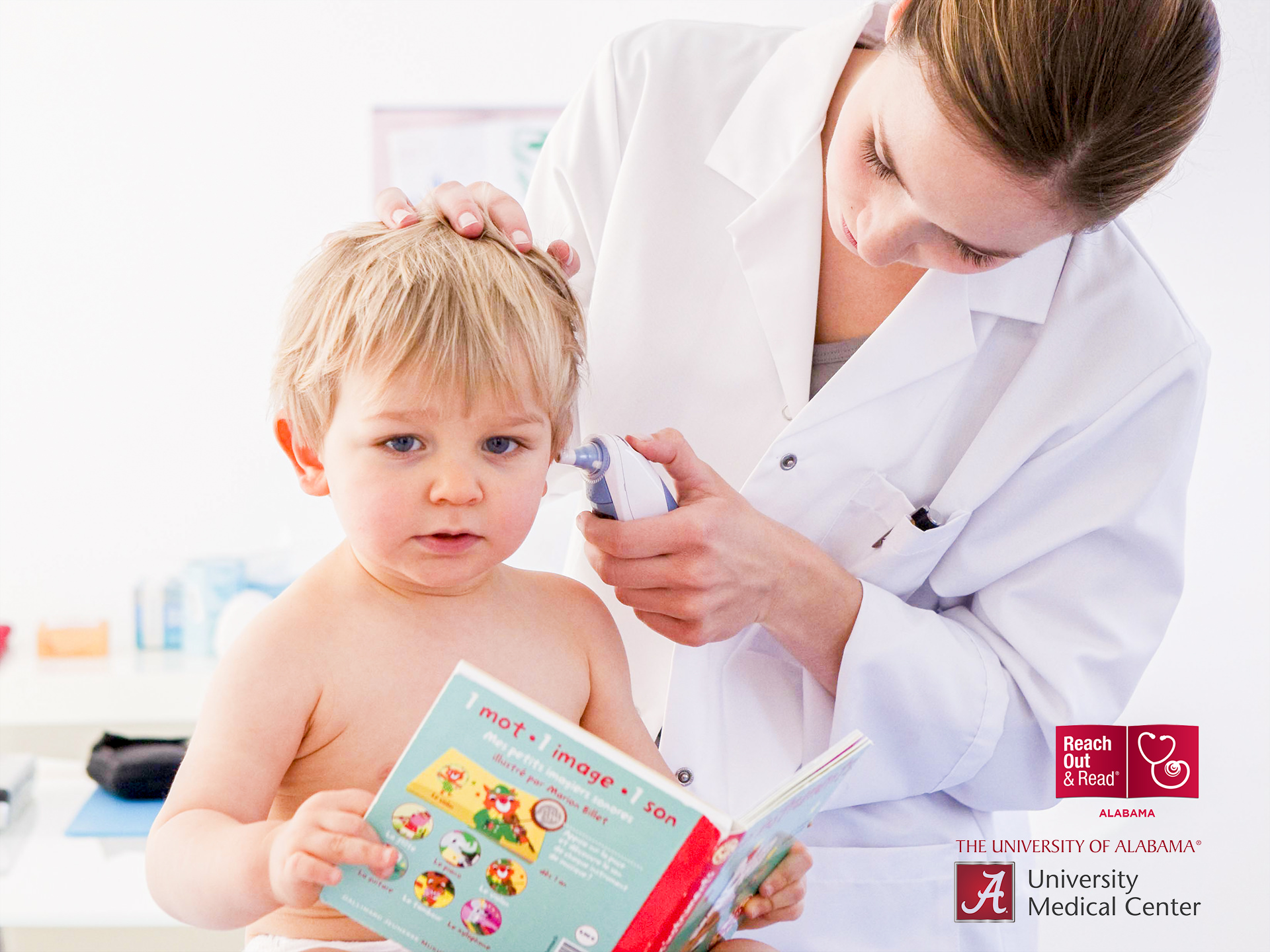 Child reading book while being examined by doctor