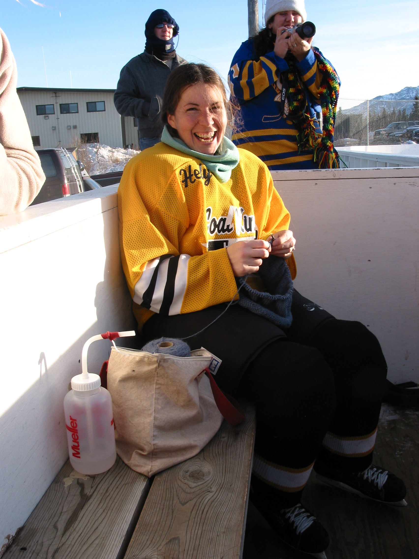 Knitting hats between hockey games, Healy, Alaska, 2003.