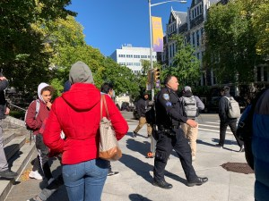Students and security officer on the City College of New York campus