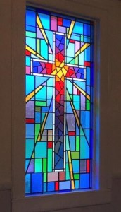 Cathedral stained glass window with cross design