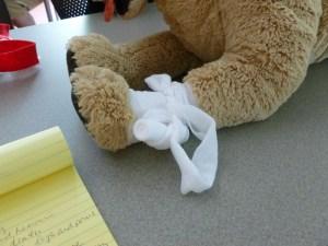 gauze bandage on toy dog's leg