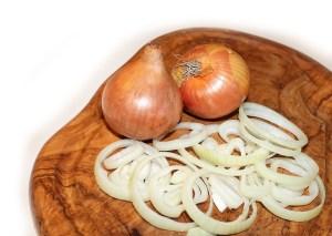 Sliced onions on a cutting board