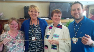 "Sharilyn Upsdell with Heron Grove Staff and an elastic band - ""a flexible team"""
