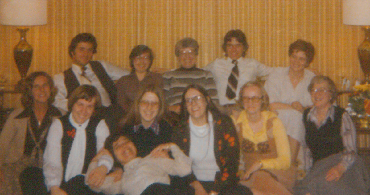 Christmas party at Kay's with CCS students and Kay's sons in 1977. Kay is lying in Ann's lap.
