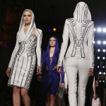 Models present creations by Italian designer Donatella Versace as part of her Haute Couture Spring/Summer 2014 fashion show for Atelier Versace in Paris