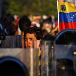 Opposition demonstrators block the city's main highway during a protest against Nicolas Maduro's government in Caracas