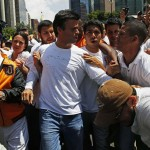Venezuela's opposition leader Leopoldo Lopez, wanted on charges of fomenting deadly violence, walks through a demonstration of his supporters in Caracas