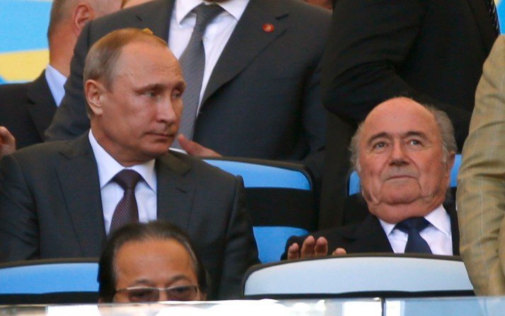 Russia President Vladimir Putin sits with FIFA President Sepp Blatter before the 2014 World Cup final between Germany and Argentina at the Maracana stadium
