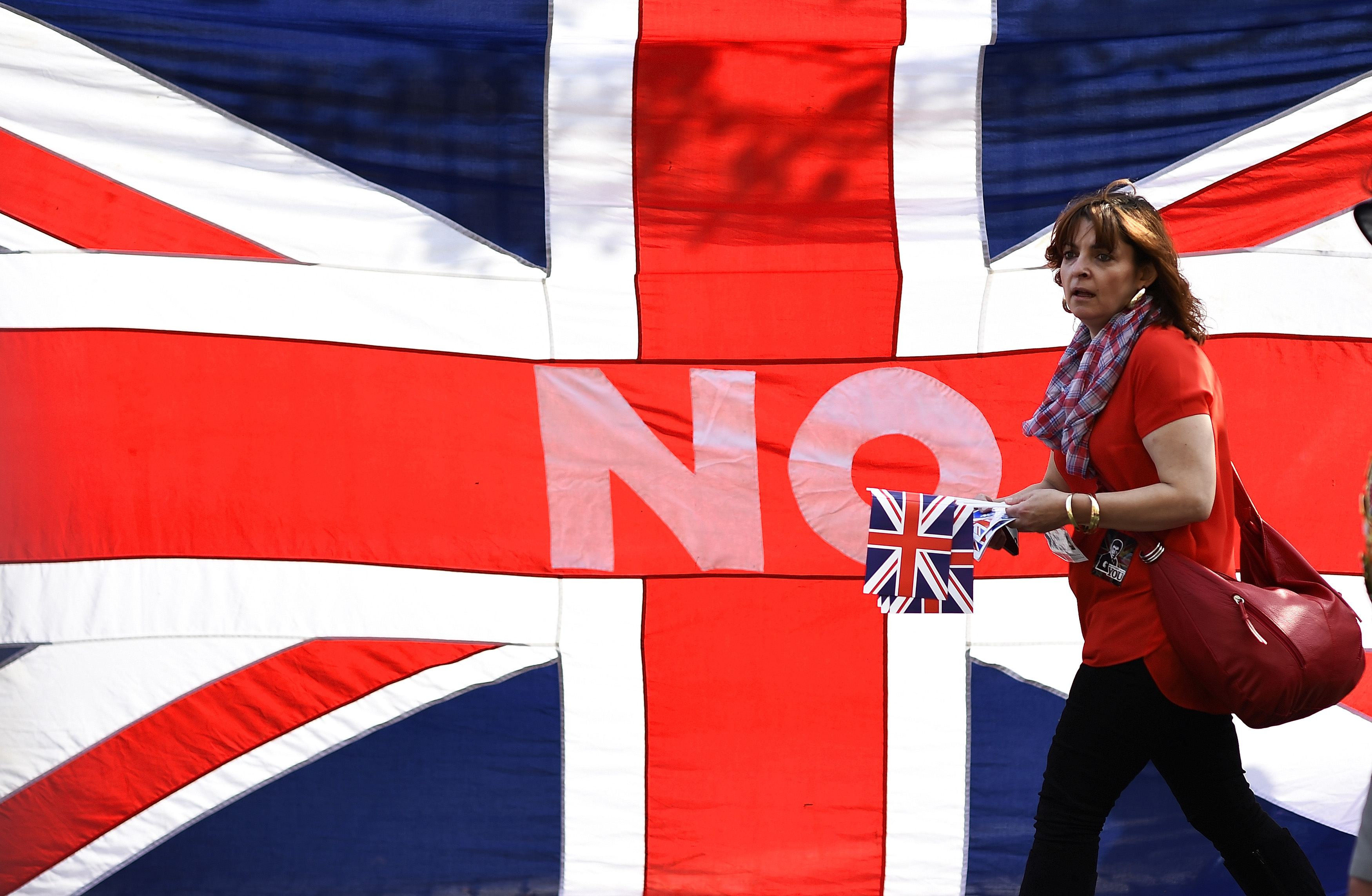 A loyalist marches past a Union flag during a pro-Union rally in Edinburgh, Scotland