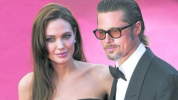Con el anilloAngelina Jolie y Brad Pitt, en el Festival de Cannes. Ayer, él mostró la alianza en la presentación de una película.