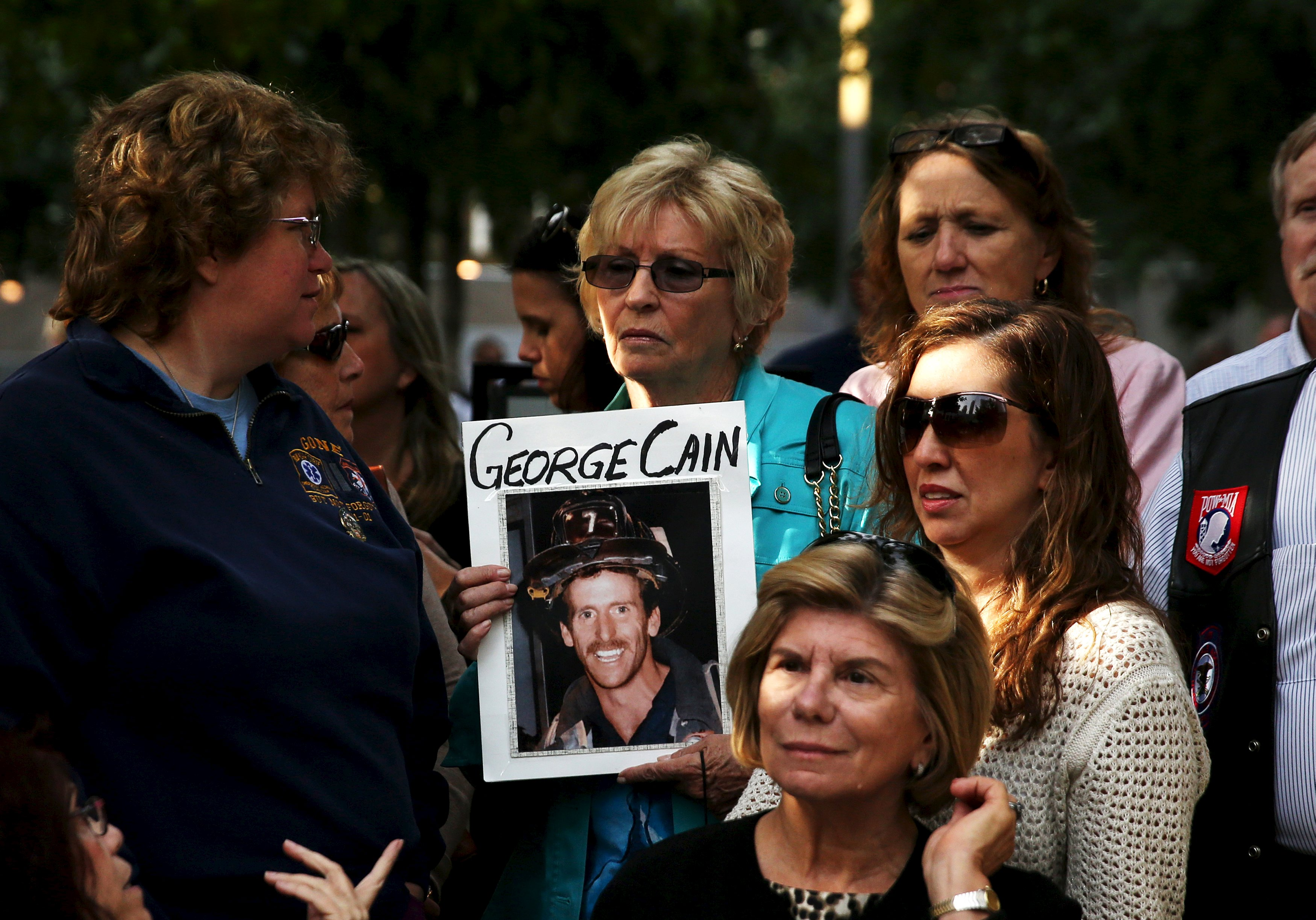 Rosemary Cain, holds a picture of her son George Cain from FDNY Ladder Company 7 who died in the September 11 attacks, at the site where the World Trade Center was, in New York September 25, 2015. Pope Francis is expected to visit the site as part of his five-day trip to the United States. REUTERS/Shannon Stapleton