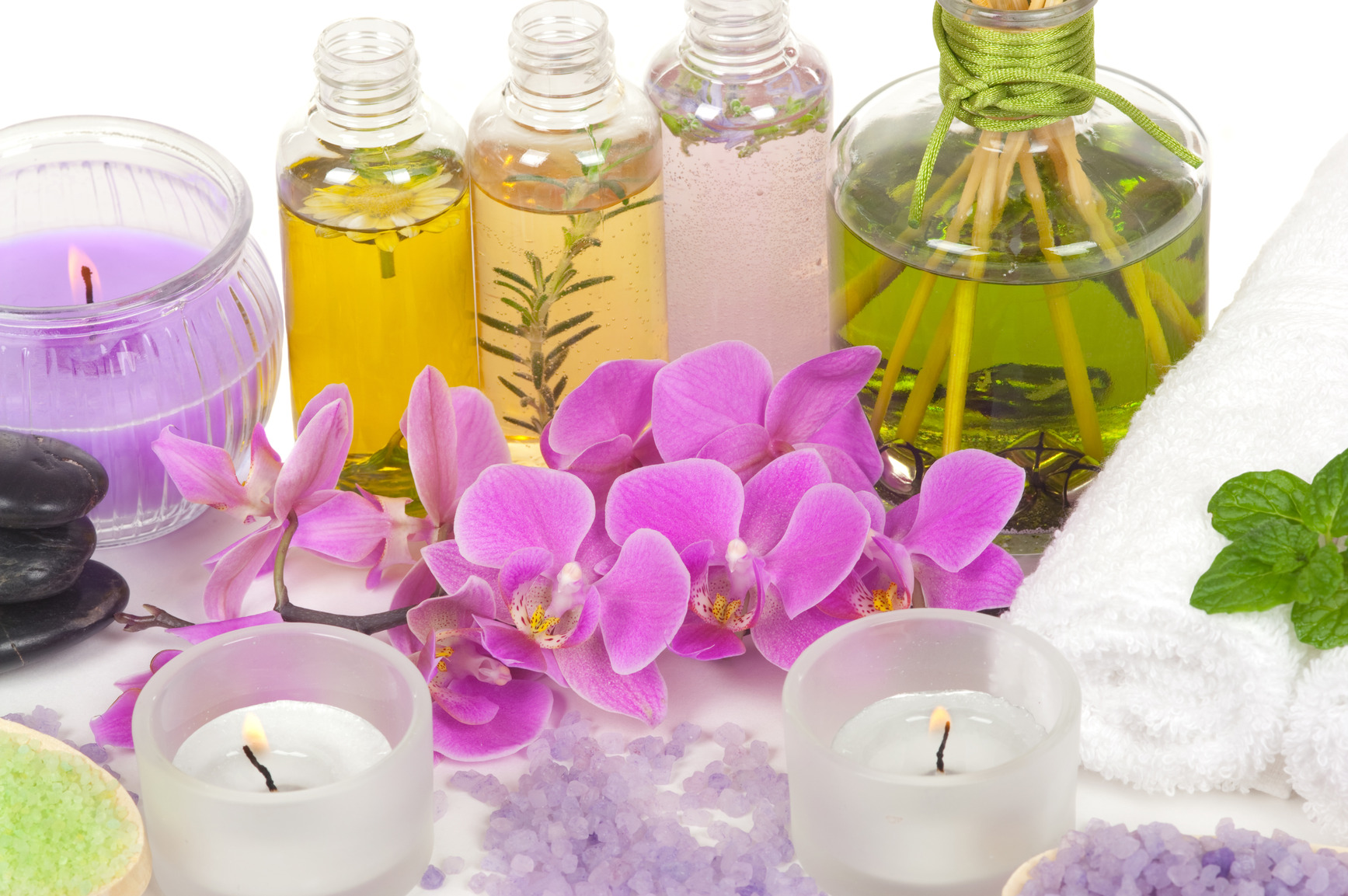 Spa scene with aromatherapy, massage oil, bath salt, orchid and aromatic candles