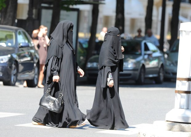 Illustration of women wearing full Islamic veil ( Burka or Niqab ) on Avenue Montaigne in Paris, France on July 7, 2010 as France may ban women from wearing burka in public, a law banning face-covering in public places will be submitted to parliament.