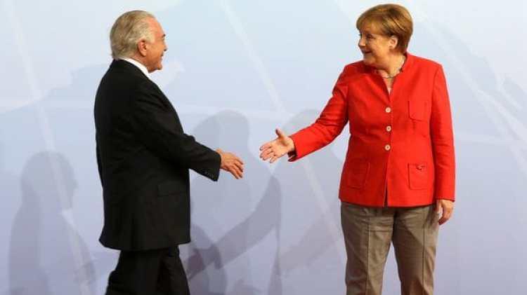 Temer saluda a Merkel, anfitriona de la reunión del G-20 (Reuters)