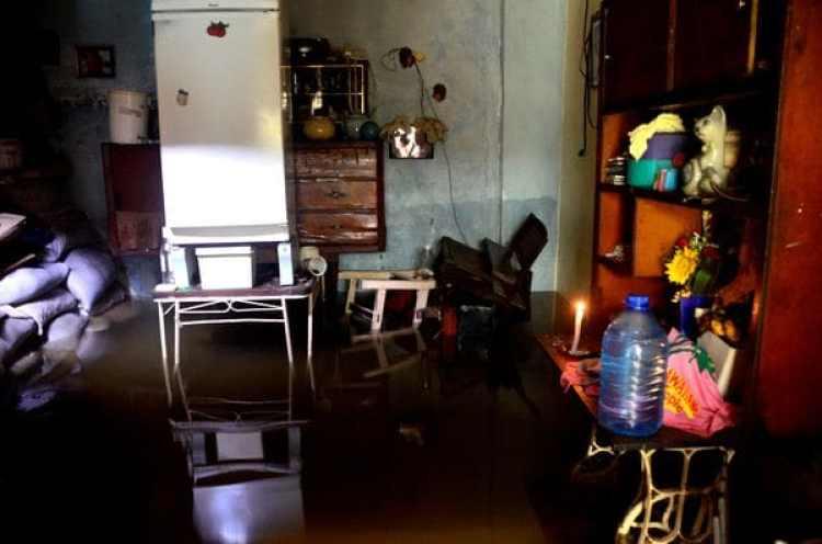 Una casa afectada por las inundaciones que provocó Irma.Los destrozos que causó el huracán volvieron a visibilizar las difíciles condiciones de vida en la isla (AFP)
