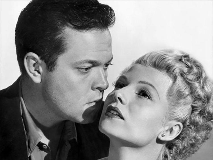 Con Orson Welles, uno de sus maridos y padre de una de sus hijas