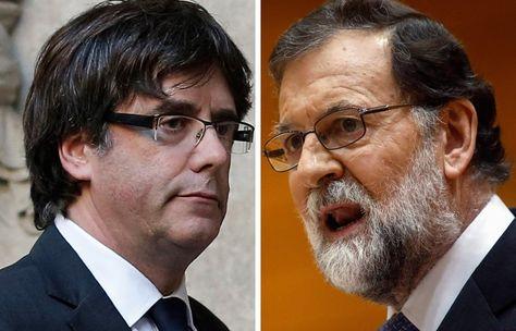 El presidente catalán Carles Puigdemont (izq.) frente al jefe del Gobierno español, Mariano Rajoy