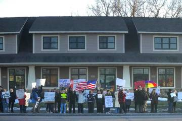Citizens rally outside the offices of Rep. Jason Lewis.