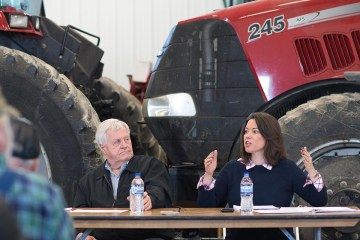 Angie Craig and Collin Peterson at a farm event.