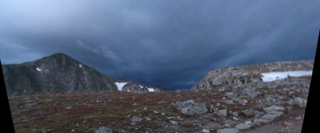 Mile 4: First light just below Flattop's summit. Doesn't look too nice out to the west.