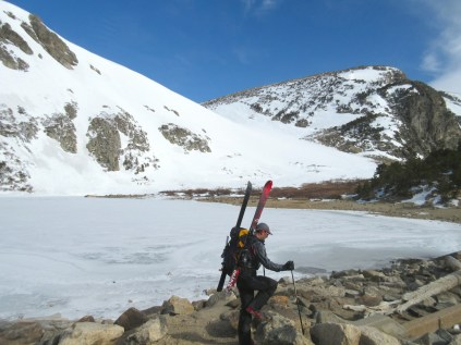 Carrying skis up to the base of the glacier.