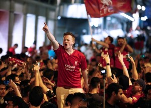 Liverpool fans celebrate at Puerta del Sol in Madrid