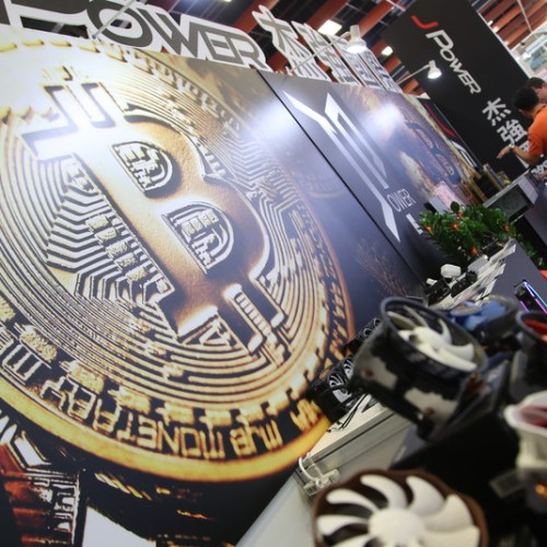 Bitcoin off record highs, slumps 7% in volatile trade