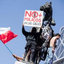 epa07941795 Protesters participate in a demonstration at the central Plaza Italia, in Santiago, Chile, 22 October 2019. A new curfew was decreed for the night in different cities of Chile and is the fourth consecutive in Santiago, Valparaiso and Concepcion (south) since the protests that left 15 people dead, including four foreigners from Colombia, Peru and Ecuador. Thousands of people in Chile returned to the streets on 22 October, for the fifth consecutive day, to protest against the Government amidst the states of emergency and the new curfews already decreed in several areas of the country. Unrest, sparked by a hike in metro fares, quickly morphed into a wider protest against social inequality. EPA-EFE/ALBERTO VALDES