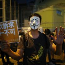 epa07870612 A anti government protester wearing a mask holds up a poster that says ?Five demands, not one less? during a rally outside Queen Elizabeth stadium where Hong Kong Chief Executive Carrie Lam attends a meeting with selected participants in Hong Kong, China, 26 September 2019. Lam is holding her first dialogue with the community with a sample of 150 participants selected randomly. Hong Kong has entered its fourth month of mass protests, originally triggered by a now suspended extradition bill to mainland China that have turned into a wider pro-democracy movement. EPA-EFE/FAZRY ISMAIL