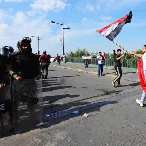 Iraqi police fire live shots, tear gas at Baghdad protesters