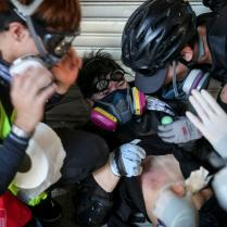 epa07885228 Anti-government protesters help an injured demonstrator during a protest on National Day in Hong Kong, China, 01 October 2019. Hong Kong has witnessed several months of ongoing mass protests, originally triggered by a now withdrawn extradition bill to mainland China that have turned into a wider pro-democracy movement. EPA-EFE/JEROME FAVRE