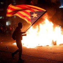 Protesters burn containers in the surroundings of Camp Nou stadium during a Spanish La Liga soccer match between FC Barcelona and Real Madrid at Camp Nou stadium, in Barcelona, Spain, 18 December 2019. EPA-EFE/Andreu Dalmau